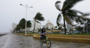 High winds battered the sea front in Manila Bay