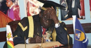 Mr Mugabe reverted to wearing a previous cap, also thought to be too small, for the October ceremony