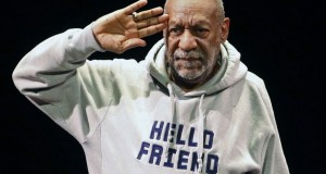 Jan. 17, 2015. Bill Cosby salutes the crowd as he begins a performance at the Buell Theater in Denver. (The Associated Press)