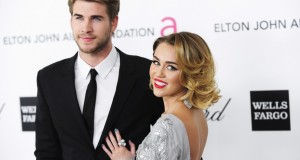 Singer Miley Cyrus (R) and actor Liam Hemsworth arrive at the 20th annual Elton John AIDS Foundation Academy Awards Viewing Party in West Hollywood, California February 26, 2012. (Reuters)