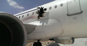 The hole in the fuselage appeared close to the wing