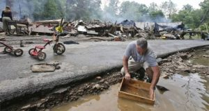 Flooding has destroyed more than 100 homes in some areas of West Virginia