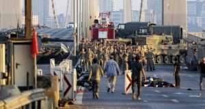 Dozens of soldiers who took part in the attempted coup surrendered to the authorities on Istanbul's Bosphorus Bridge