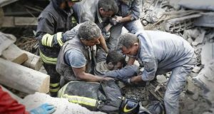 Rescuers struggle to free survivors