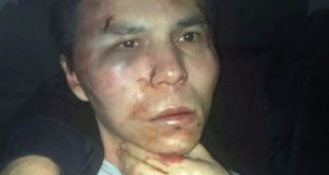 Police released a photo of the bloodied detainee
