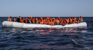 This 12 January photo shows migrants crowded on to an inflatable dinghy before rescue off Libya's coast