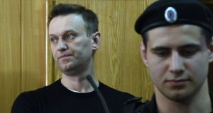 Alexei Navalny (left) called for nationwide protests over alleged government corruption