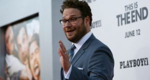 "Director, writer and cast member Seth Rogen waves at the premiere of ""This Is the End"" at the Regency Village Theatre in Los Angeles, California June 3, 2013.  (Reuters)"