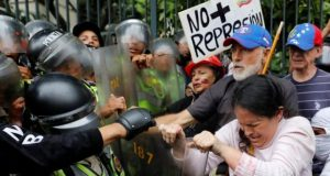 """No more repression"" reads a banner held during the ""Grandparents March"" in Caracas"