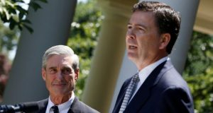 Robert Mueller (L) with his successor at the FBI James Comey, whose dismissal prompted calls for a wider investigation