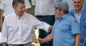 President Santos (left) and Farc leader Timochenko attended a ceremony in Mesetas