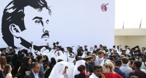 Qatar Airways workers rallied in support of the country in front of a portrait of Emir Sheikh Tamim bin Hamad al-Thani in Doha
