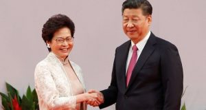 Carrie Lam shakes hands with President Xi after swearing an oath of office in Hong Kong