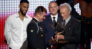 Sadler, Skarlatos and Stone received an award from Eastwood at a 2016 event