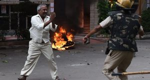 Media captionViolent clashes have taken place in Panchkula (footage by Sudeep Sachdeva)