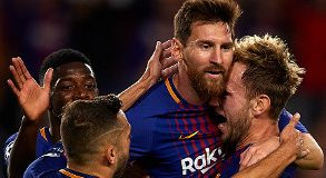 Lionel Messi embracing his teammates © Getty Images
