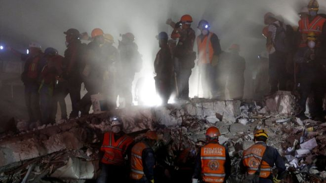 Workers dug through toppled buildings in Mexico City for a second night