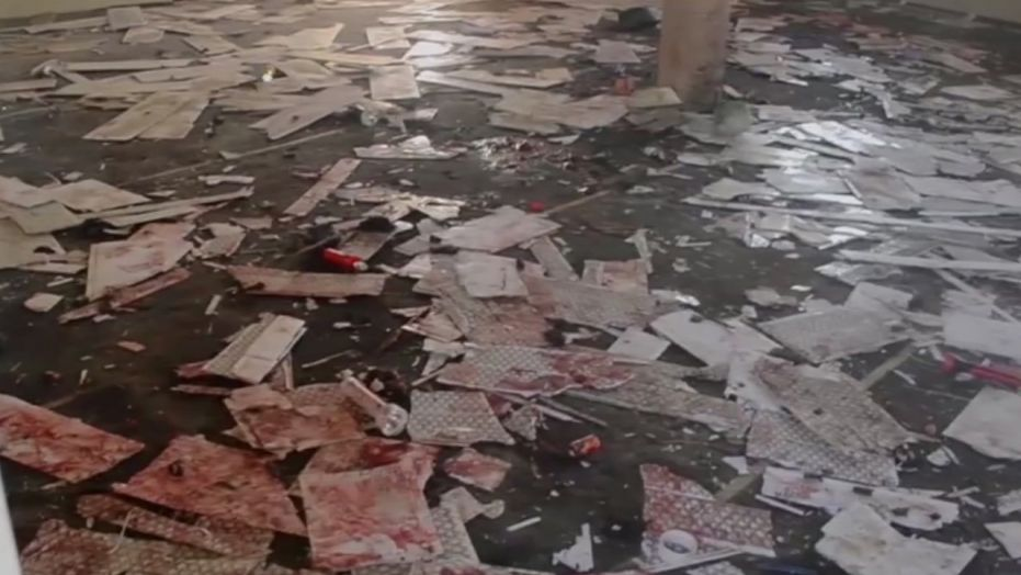 This image taken from TV, shows the interior of a mosque after a deadly attack