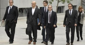 Members of the deposed Catalan regional government arrive at court in Madrid