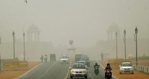 New Delhi: Vehicles ply on smog covered Rajpath in New Delhi on Saturday. PTI Photo by Manvender Vashist