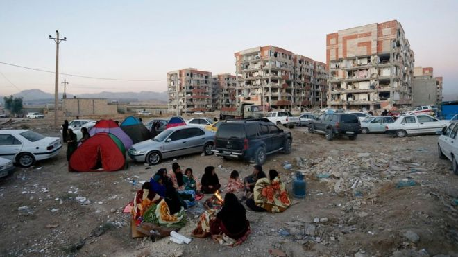Iranians set up temporary camps outside of shaken buildings in Pole-Zahab, Kermanshah province