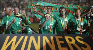 Zambia national team players celebrate their victory as they pose with their gold medals