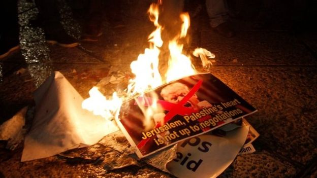 Palestinian protesters burned pictures of Donald Trump in the West Bank