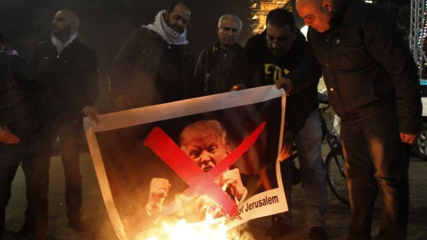 Palestinian protesters burned pictures of Donald Trump on Tuesday