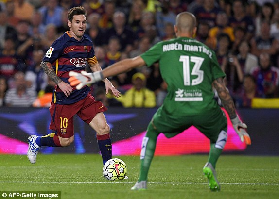 Lionel Messi is confronted by Levante keeper Ruben