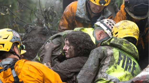 Fire department workers rescued a woman from a collapsed house in Montecito