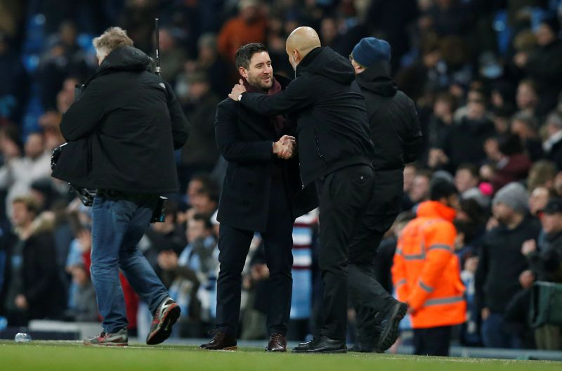 Pep Guardiola with Lee Johnson