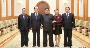 This handout photo by KCNA shows Kim Jong-un, who appears to be supported by Ms Kim Yo-jong on his left and Mr Kim Yong-nam on his right