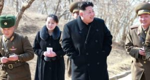 Kim Yo-jong in a 2015 picture of her brother touring a military unit