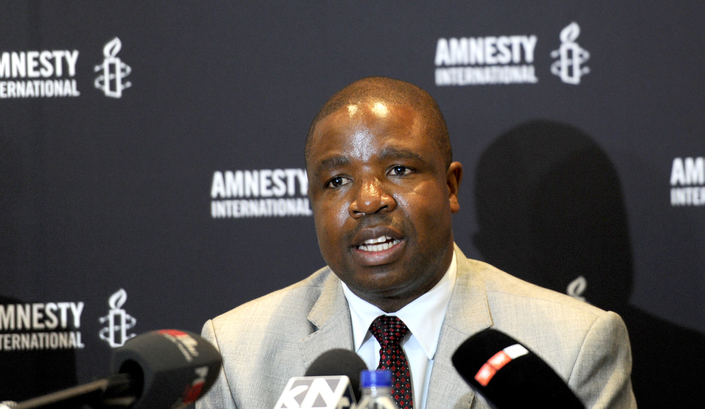 Deprose Muchena, Amnesty International's director for the Southern Africa region speaks at a news conference held by the organisation in Johannesburg to highlight human rights abuse, Wednesday, 25 February 2015. Picture: Werner Beukes/SAPA